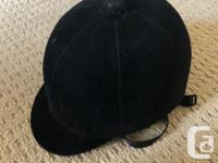 This an International riding helmet in black velvet for