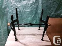 One of a kind heavy wrought iron base. Base for legs