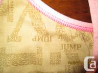 This pink Ivivva by Lululemon Tumblin Storage tank with