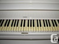 This is a pretty Ivory upright piano that was purchased