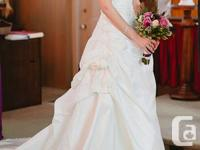 I have a beautiful ivory wedding dress with lots of