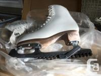 Size 8 Like new, still in box. Blade guards included.