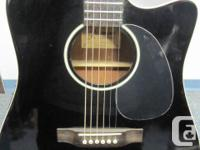 This is a used Jasmine by Takamine acoustic guitar with