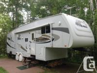 Unique fifth-wheel floor plan in immaculate condition!