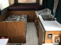 1996 Jayco double-axel tent trailer. King sized bed on