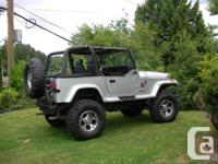 YJ V8 350 chevy 5 speed 11 inches lift 36 inch swawpers