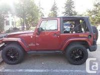 Make. Jeep. Design. Wrangler. Year. 2009. Colour. Dark