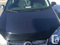 Make Volkswagen Model Jetta Year 2009 Colour Bleu kms