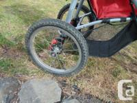 Fixed wheel Safety First jogging stroller. Very good