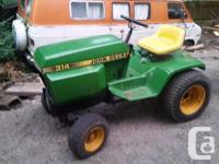 For sale John Deere 314 garden tractor. 14hp single