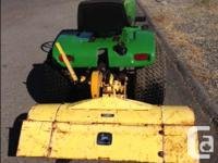 John deer 314 with tiller, runs good ,good tires