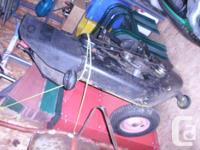 L120 John Deere Lawn mower with 48 in. mower deck. Low