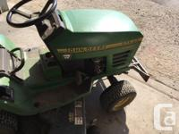 This is a John Deere STX 46 lawn tractor. It has a 14