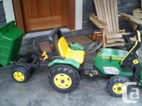 Classic JOhn Deere ride-on pedal tractor and trailer.