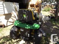 John Deere Tractor with a 42 inch cutting deck Has new