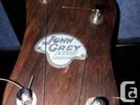 For sale is a long neck banjo made in England in the