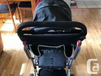 Gently used Joovy Caboose with baby seat attachment,