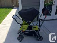 Lime green sit and stand stroller Comes with infant car