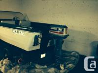 Selling my 15.5' boat with 35HP Evinrude. Trailer is