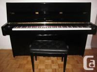 Kawai k15 upright piano. It's in excellent condition,