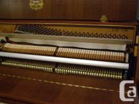 Kawai 42 inch high piano in excellent condition. Model