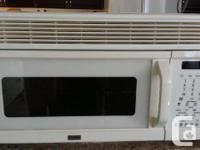 Kenmore`s best over the stove microwave. Built in