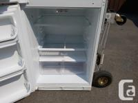 Its a fridge. Works great. White, clean and quiet. 2