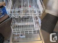Kenmore white dishwasher with stainless steel interior