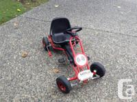 Pedal car ready to race for your child.Hand brake for
