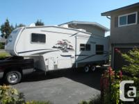 Cougar 5th wheel in excellent shape. Has electric