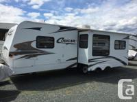 "Great condition 26'8"" Cougar Keystone travel trailer."