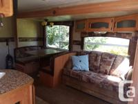 Go glamping in this 2008 RV Lots of room with the table
