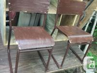 This is a cute pair of stackable chairs, circa 1950s,