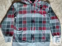 Boys Plaid Hurley Hoodie in good disorder. Dimension XL