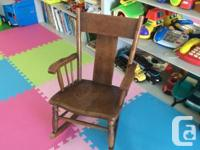 Cute rustic antique kid's rocking chair made from solid