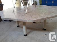 Octogon shaped table, very sturdy and stable. 5' diam.,