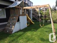 Kids swing set and play house. Has climbing wall on one