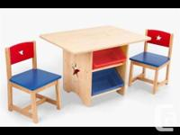 Kidkraft table and chairs with storage bins. Complete