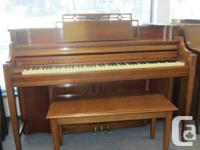 Kimball wood-grained piano with matching bench.  This