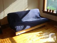 King Sized futon/couch in exceptional disorder. Clean,