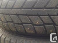 Set of 4 studded winter tires with rims. Lots of tread