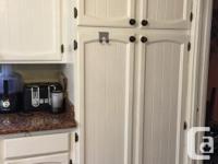 Kitchen cabinets + granite countertop + high granite