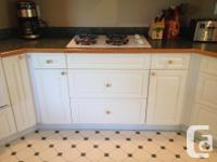 Kitchen cabinets in very good condition with white PVC