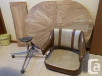Oval table plus 6 chairs on casters for sale. Table