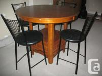 We have a beautiful Kitchen or dining room table with