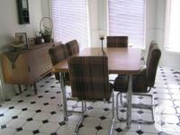 6-person kitchen dining set. Laminate wood and chrome.