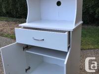 Drawer slides smoothly Shelf is adjustable Top Height-