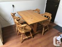 Solid pine trestle table and four IKEA pine chairs.