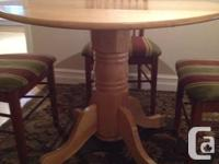 Selling my round wood kitchen table and four wood