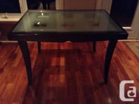 Chocolate color Italian made table, seats 4 to 8
